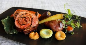 Picture of Barbacoa on a dish with carrots and onions.