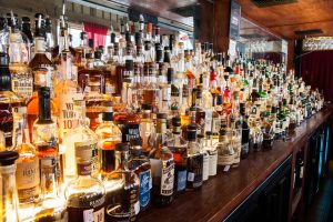 Photo of the bar at Reserve 101 and several whiskey bottles.