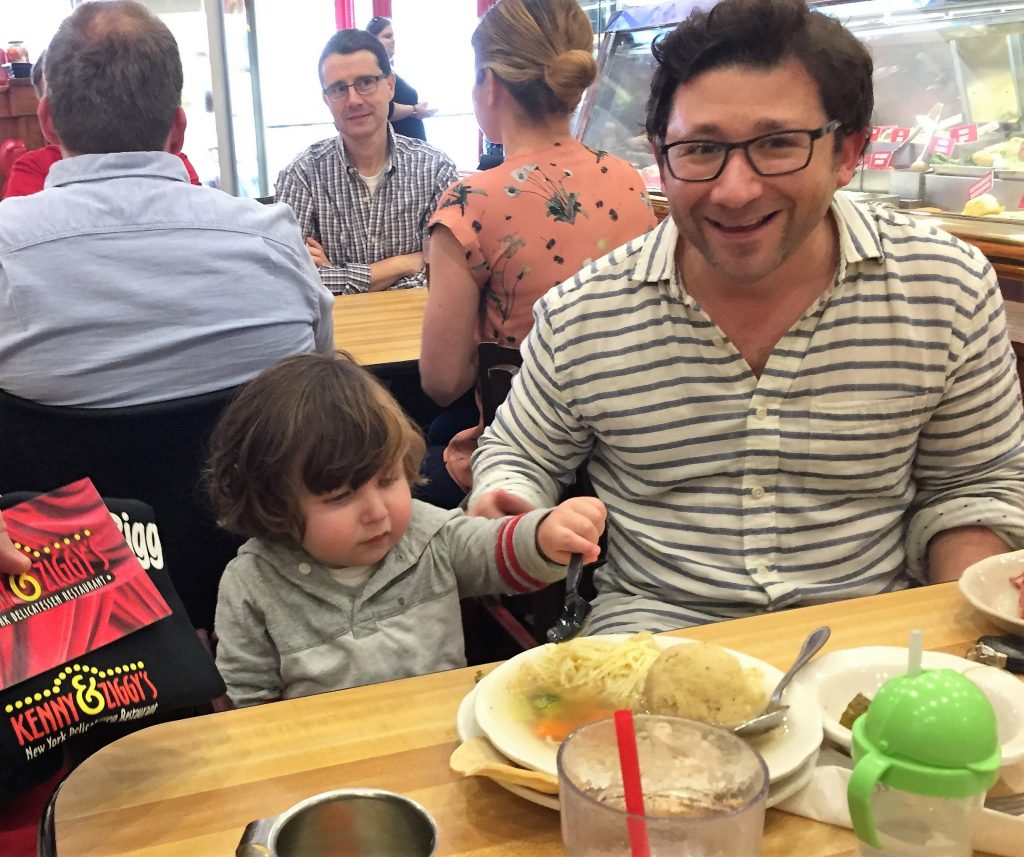 Photo of two-year-old Leo Strauss and his father, Levi, at Kenny & Ziggy's with Matzo Ball soup