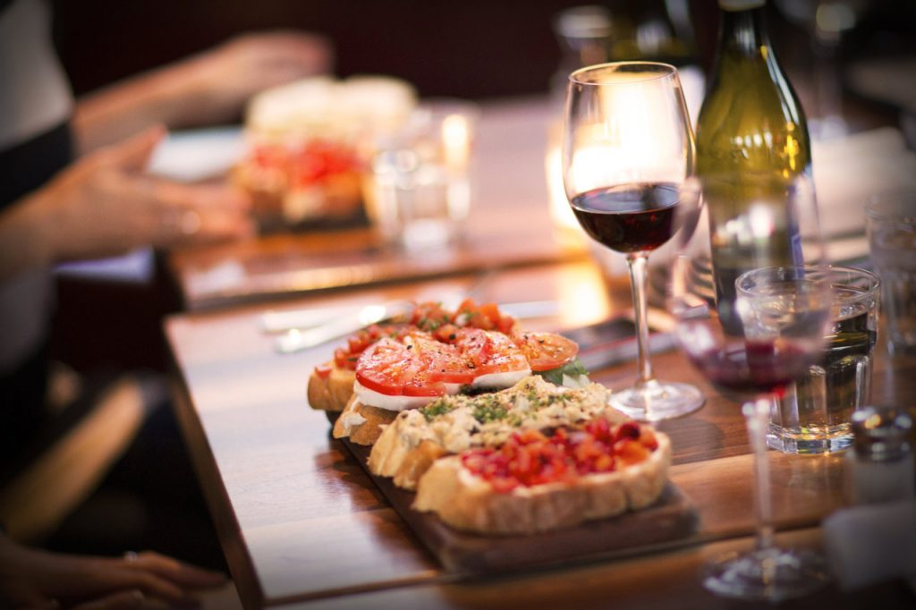 Picture of bruschetta and glasses of wine.