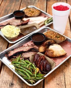 platters of barbecue meats and sides
