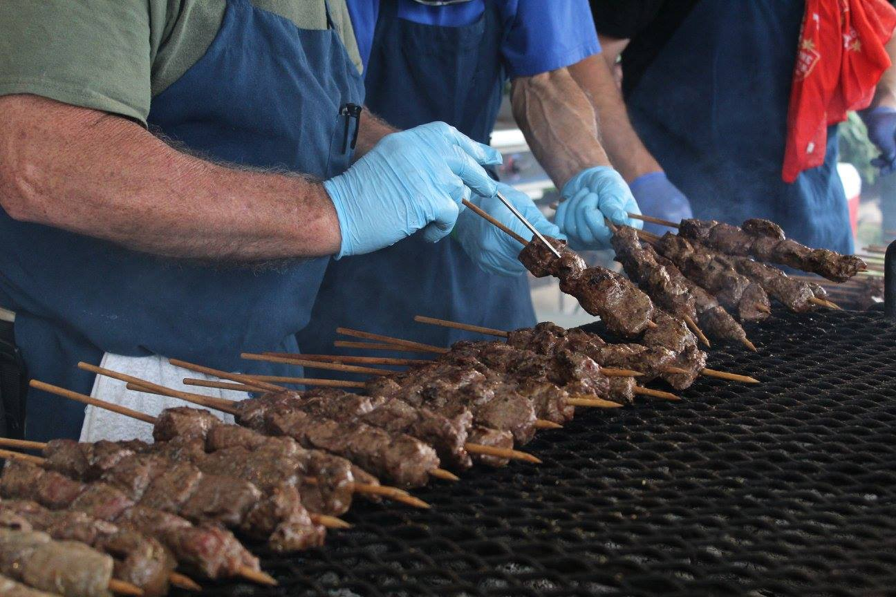 Picture of a grill lined with souvlaki