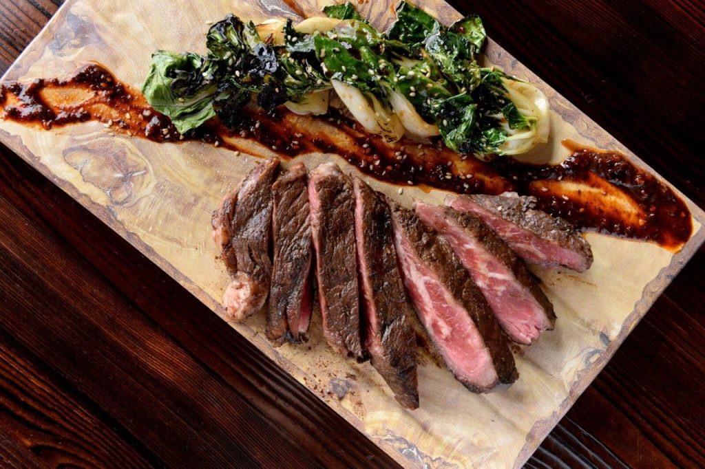 Picture of a ribeye steak on a cutting board.