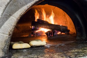 Wood-fired oven at Bistro Provence with bread