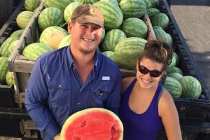 Gundermann Acres proprietors with their watermelon harvest.