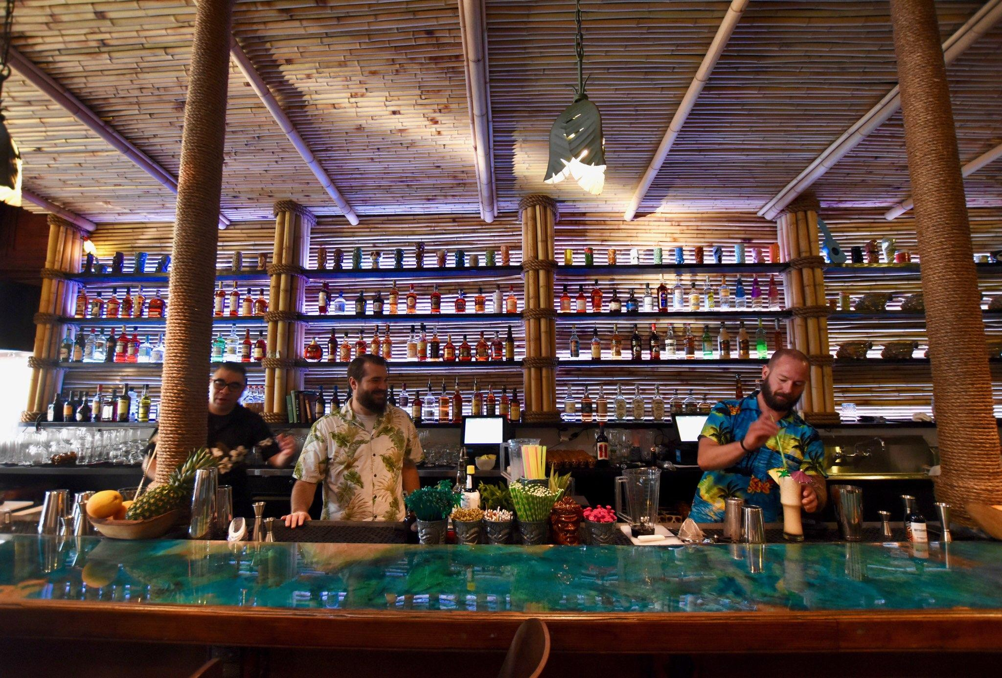 Three bartenders behind the bar at Kanaloa.