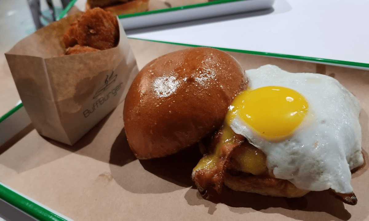Breakfast Burger with Sunny Side Up Egg by Hank Lewis