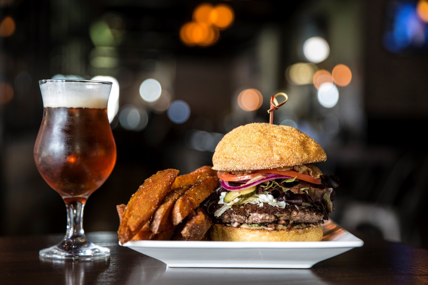 burger with fries and beer