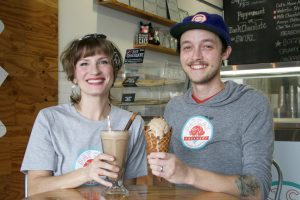 Picture of Sarah Johnston (left) holding a milk shake and Dylan Rodriguez (right) holding a waffle cone with chocolate ice cream.