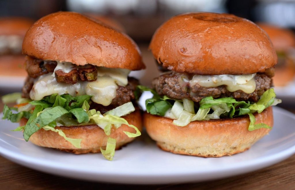 Photo of two cheeseburger sliders.