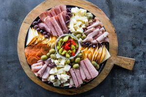 Picture of a huge plate or meats and cheese.