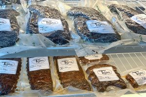 smoked meats to go at Tejas