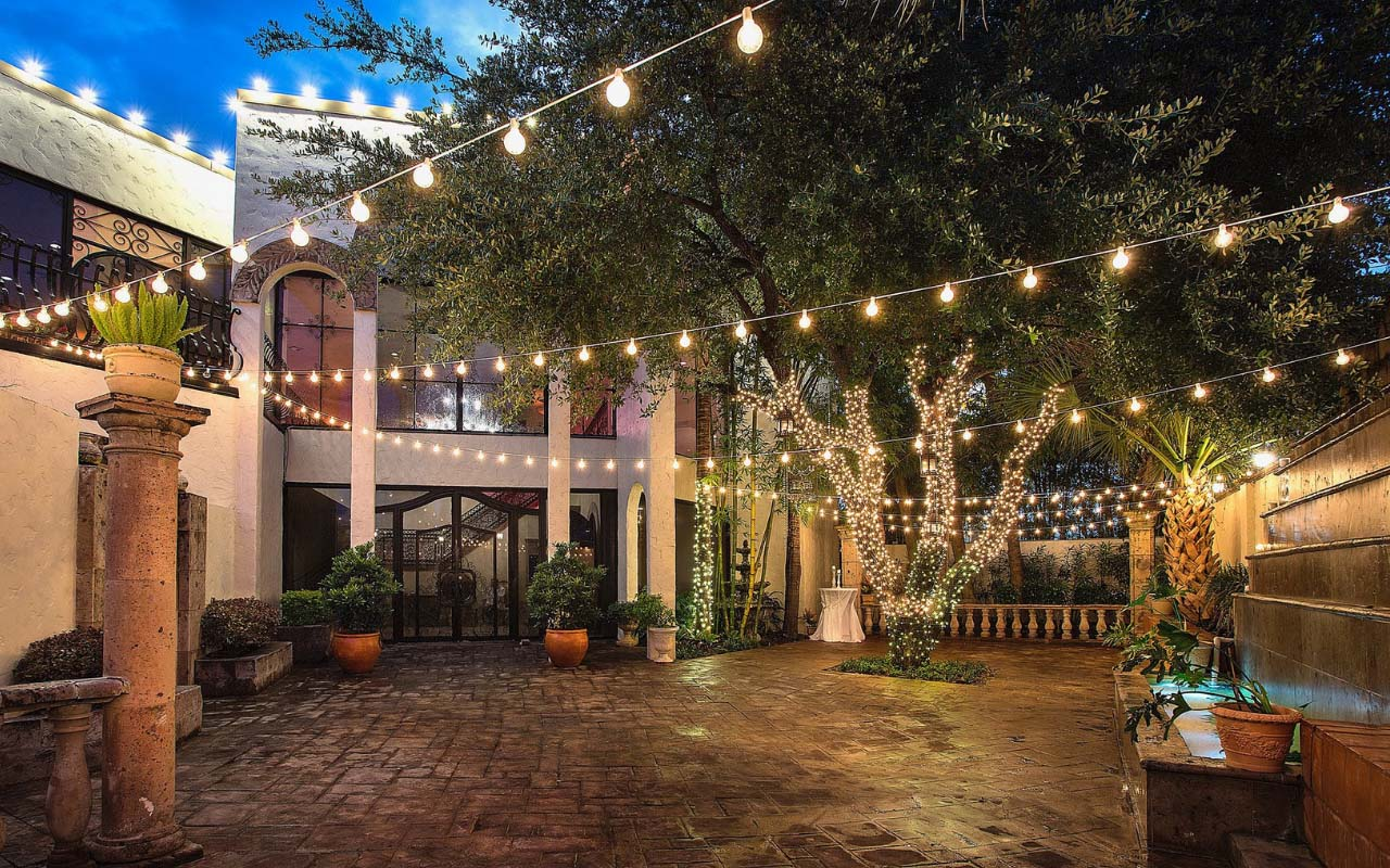 Exterior of 2840 At Dukessa courtyard at night with string lights