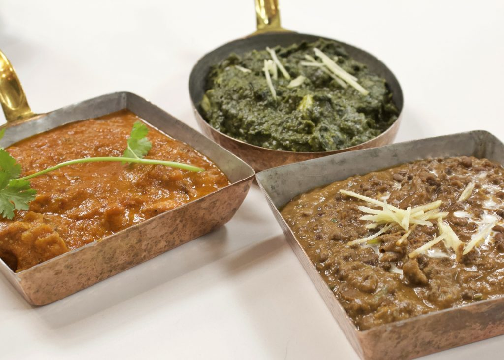 Several Indian side dishes in individual bowls.