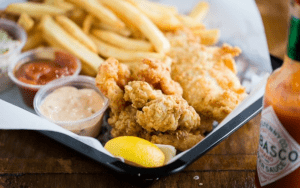 Tray of fried seafood with French fries