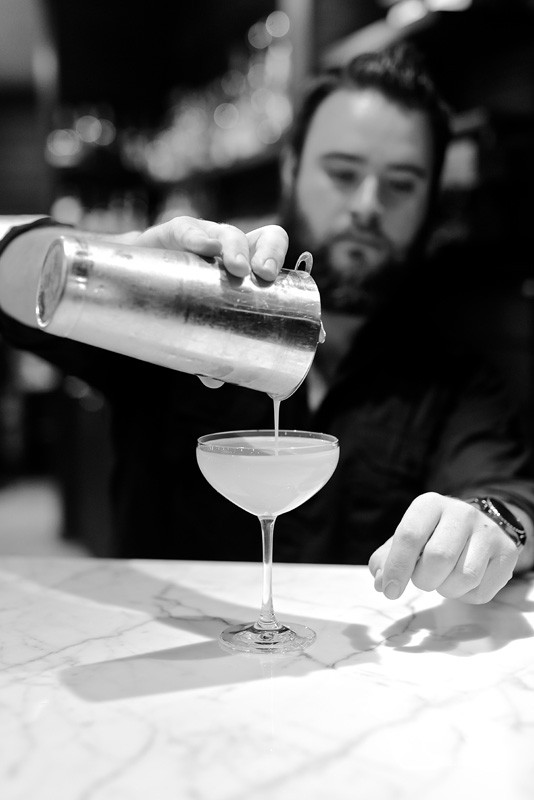 Pouring a cocktail at Killen's Steakhouse