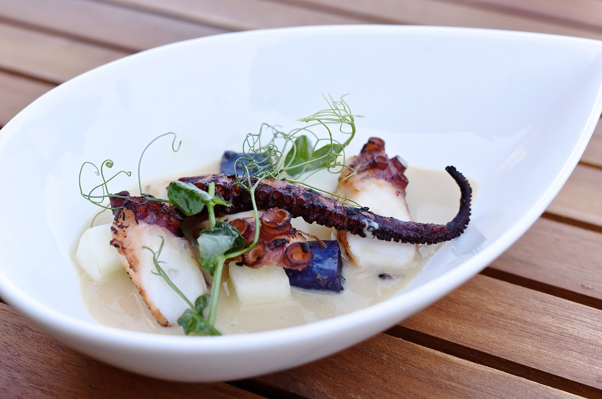 Grilled Octopus with purple potatoes, Pink Lady apple and seafood chowder at Killen's Steakhouse