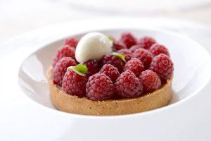 Lemon tart topped with fresh raspberries at Killen's Steakhouse