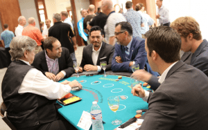 Men sitting around a poker table