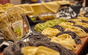 Table of dried pastas of difference colors in nested shapes