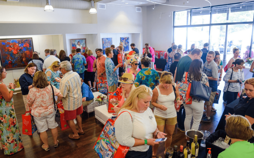 People inside a gallery sampling wine