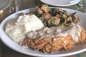 Chicken fried steak with Brussels sprouts and creamy mashed potatoes at Harold's Restaurant & Tap Room.