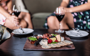 Meat and cheese board, wine