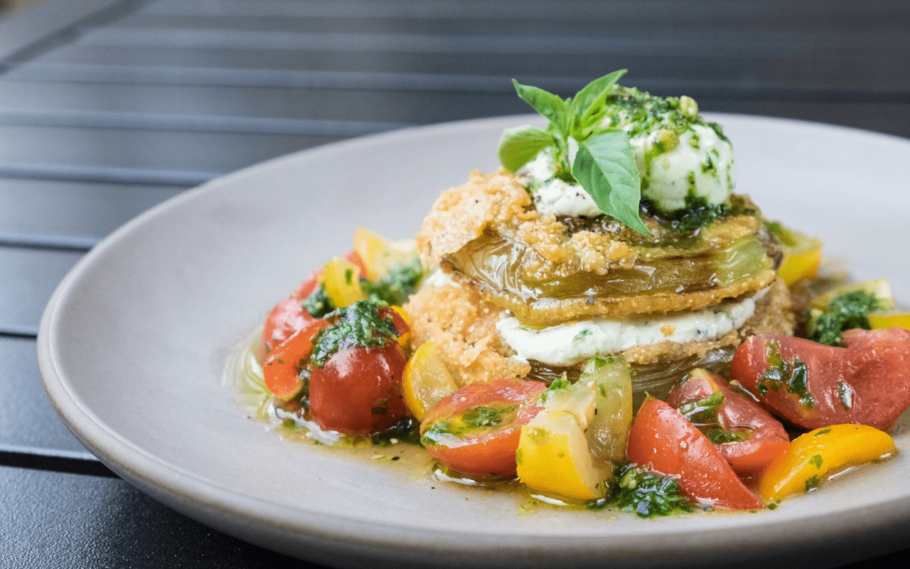 Fried green tomato slices layered with goat cheese