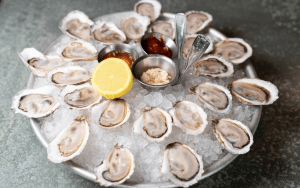Large platter of oysters on the half shell
