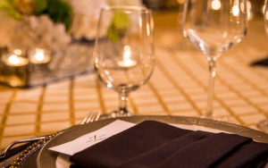 Formal place setting with wine glasses