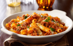 Bowl of baked ziti pasta with sauce