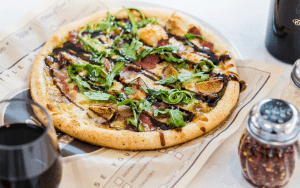 Pizza with prosciutto, figs and arugula