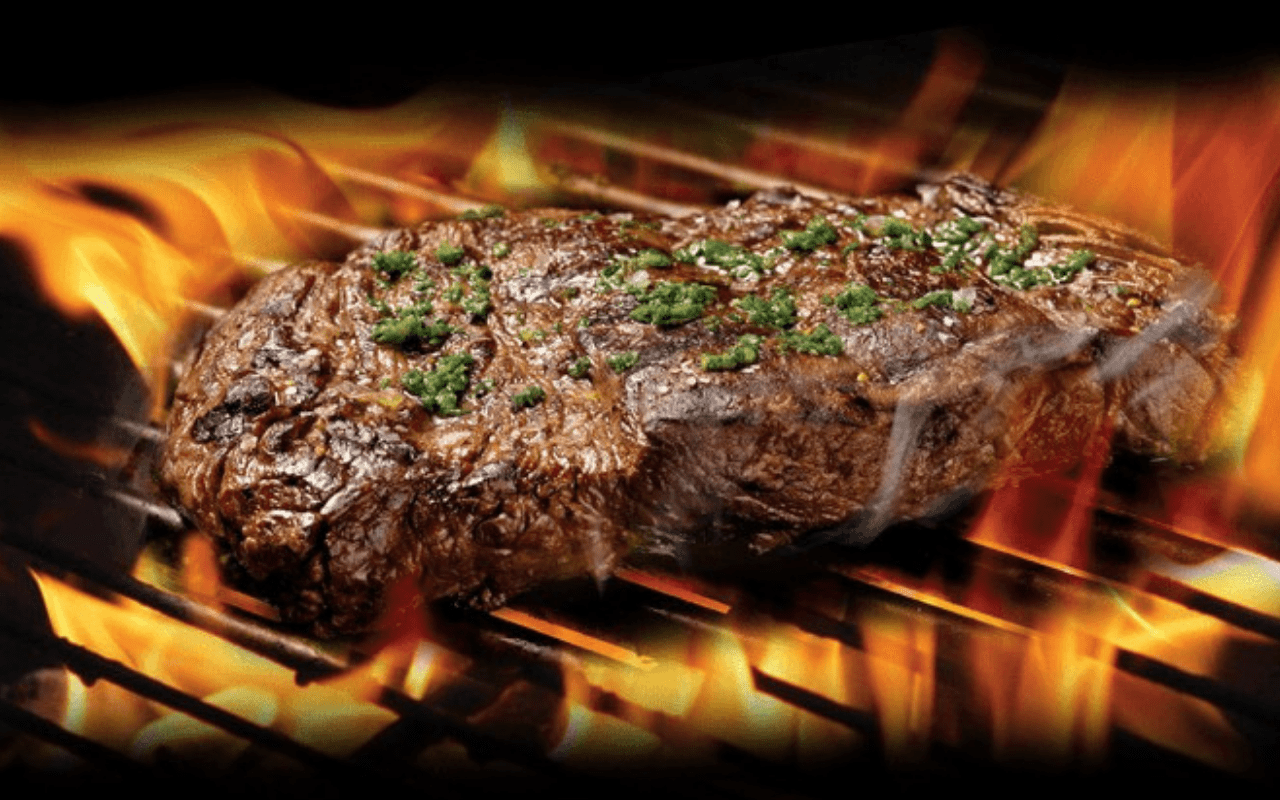 Steak cooking on flames