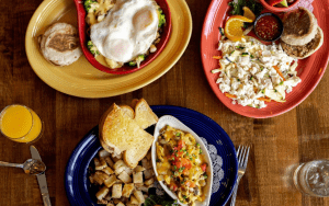 Overhead view of three brunch dishes