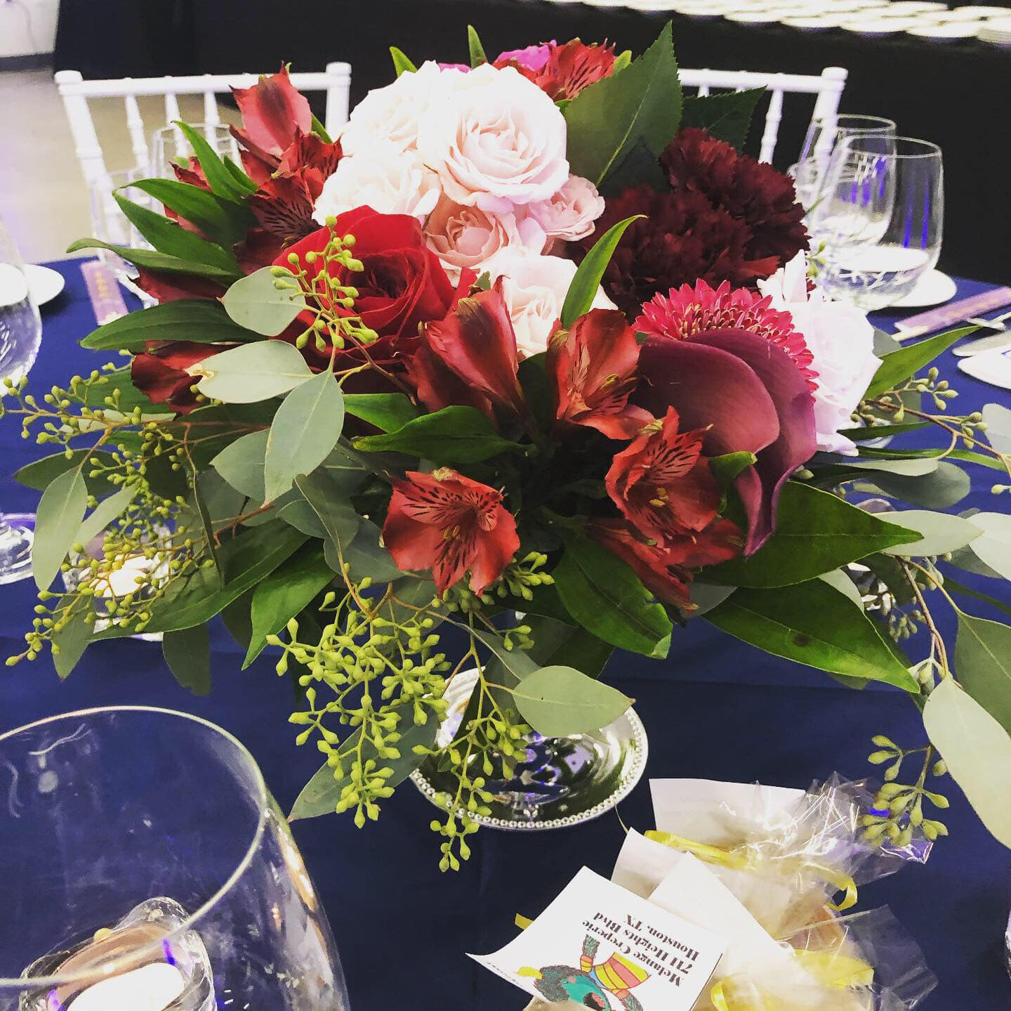 Floral centerpieces by Stephanie Coulter of Lily In June
