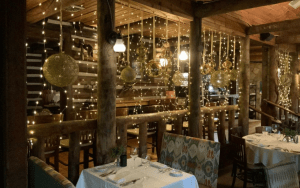 Dim dining room with white string lights