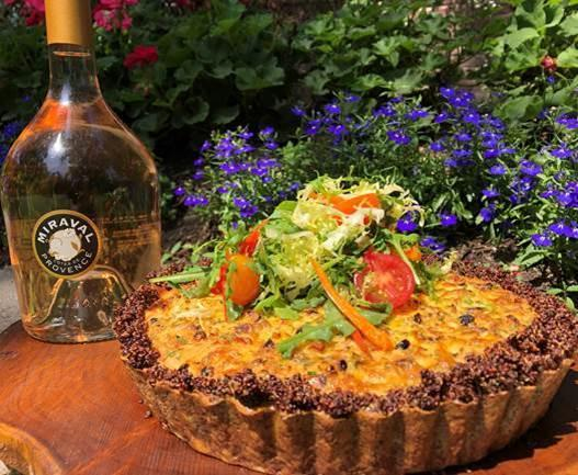 Photo of a quiche next to a bottle of Mirval rose.