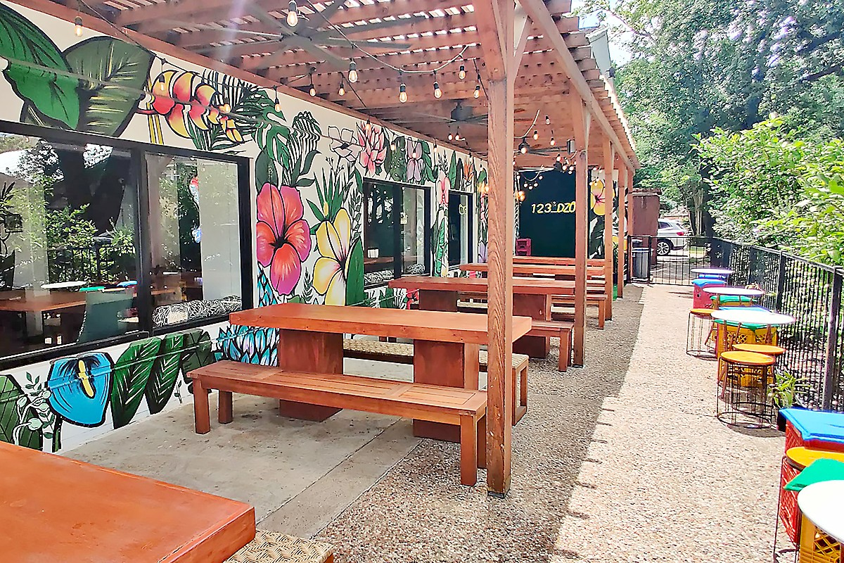 The colorful, pergola-style patio at Kau Ba Saigon in Montrose.
