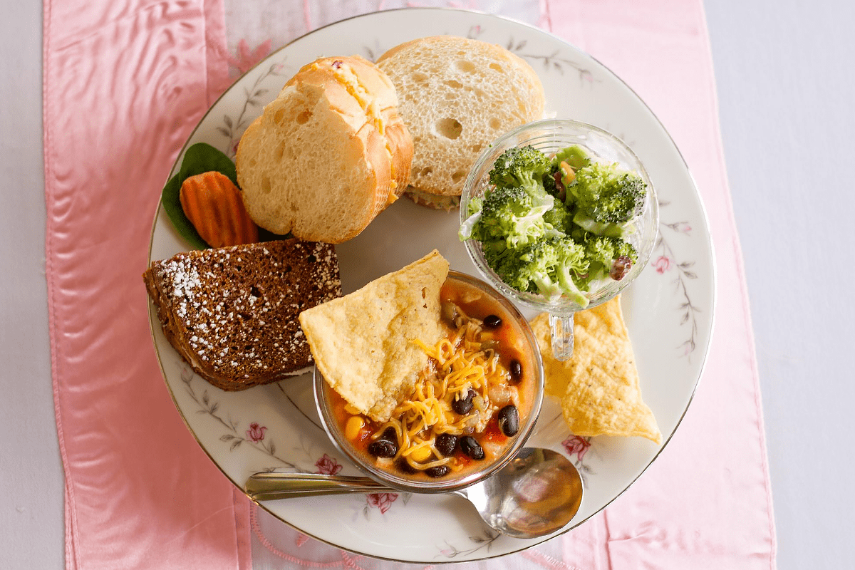 Round plate with finger sandwiches and sides