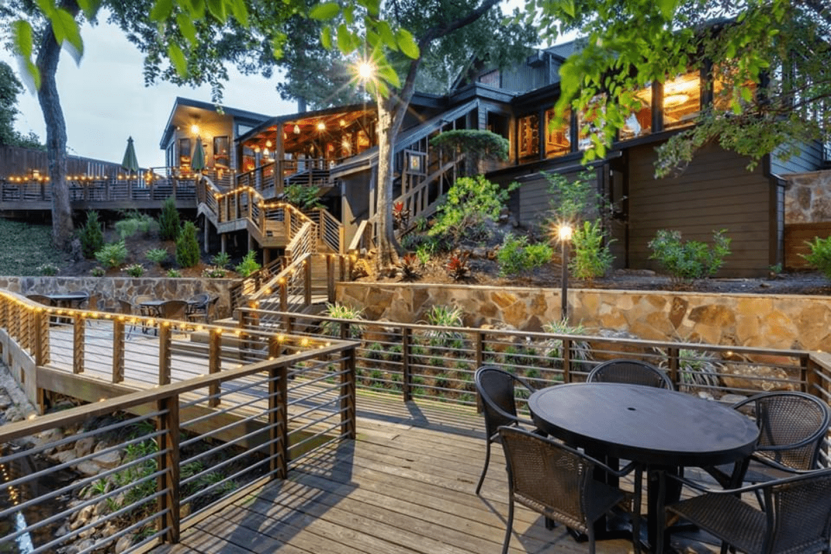 Wooden deck and patio with evening string lights