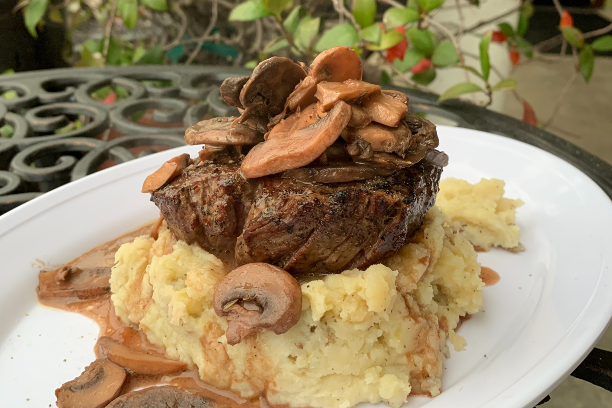 steak on mashed potatoes with mushroom sauce