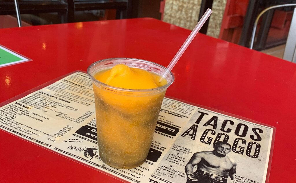 Photo of the black and orange margarita on a Tacos a Go Go placemat
