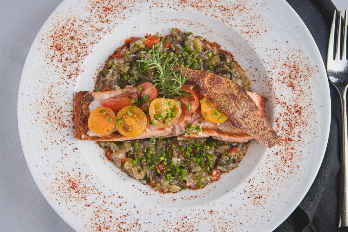 Salmon with veggies on plate