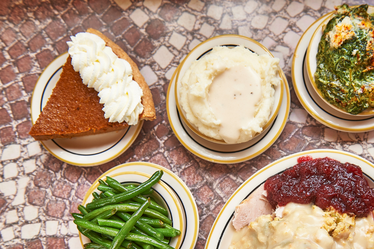 Overhead view of pie and holiday sides