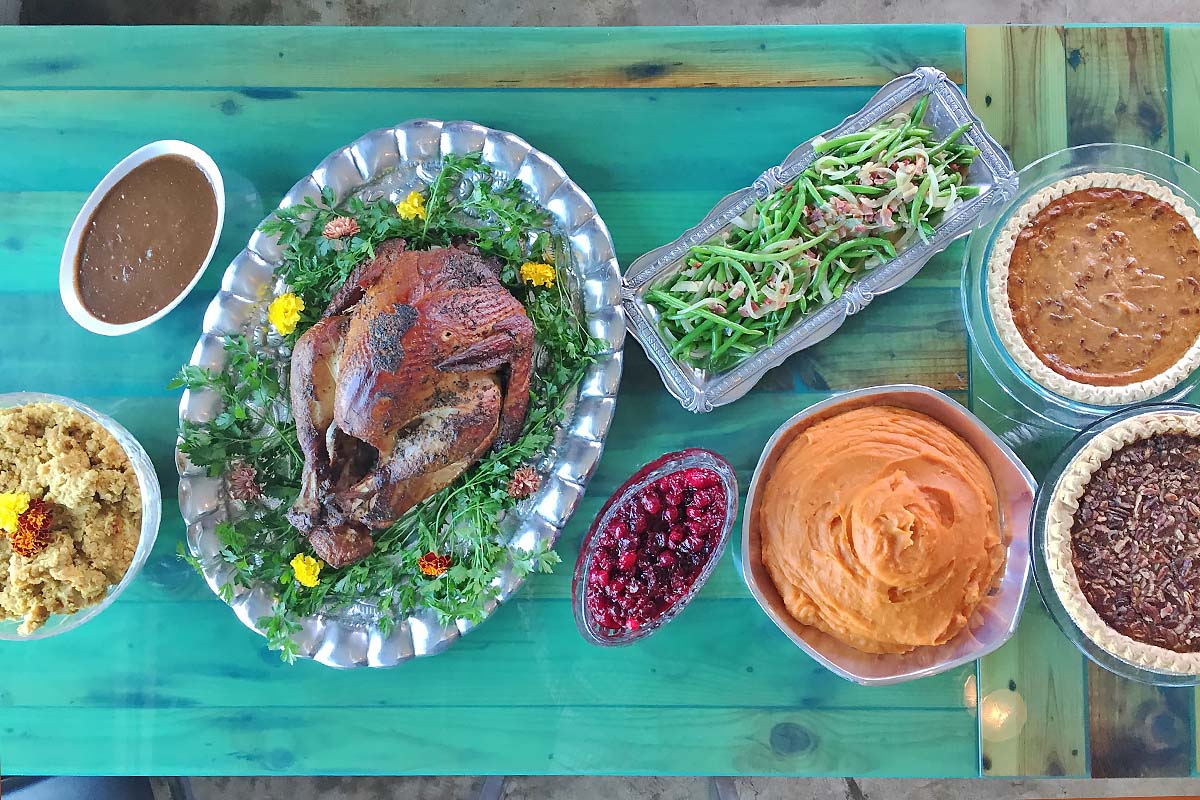 overhead view of turkey dinner and sides