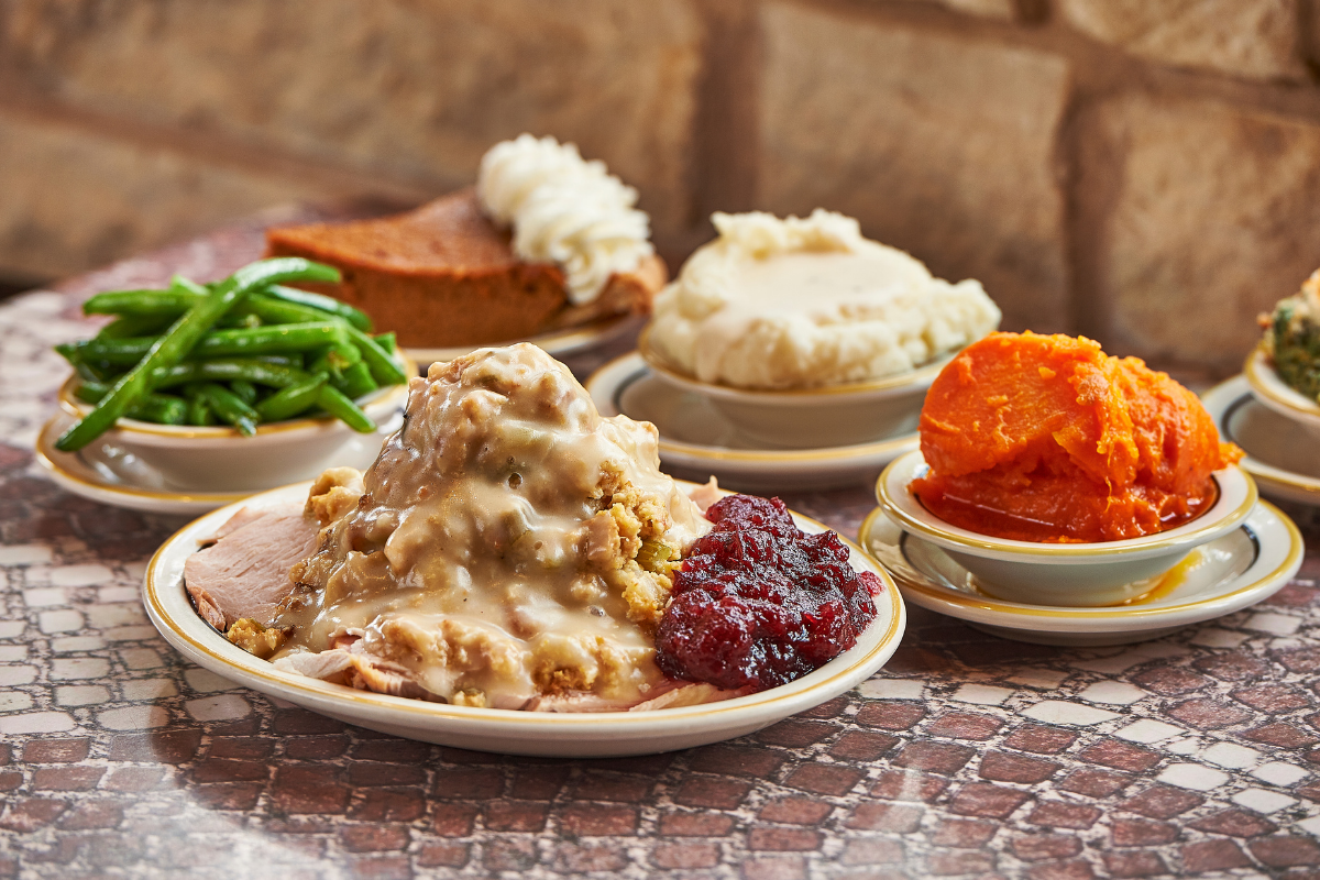 plated turkey dinner and side dishes