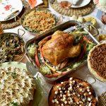 whole roasted turkey surrounded by sides