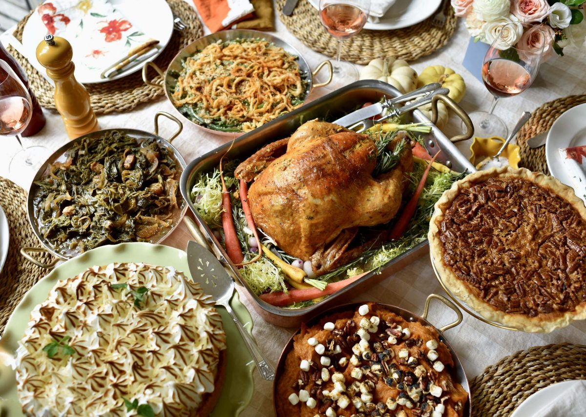 whole roasted turkey surrounded by sides