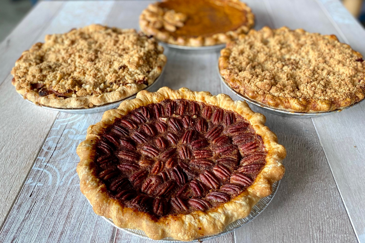 four whole pies in pecan, pumpkin and fruit