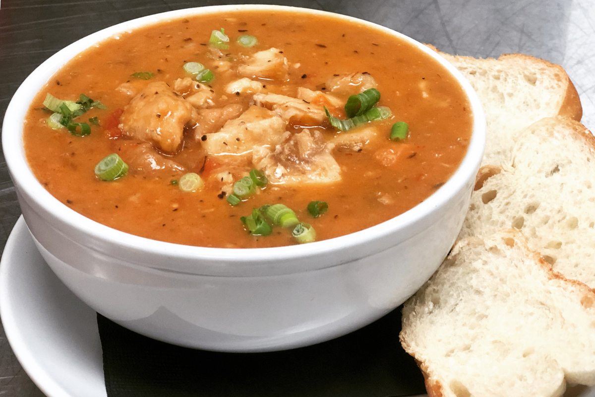 Bowl of seafood soup with bread